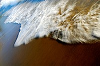 blurred white wave on beach shoreline