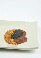 Sands and stone in square dish