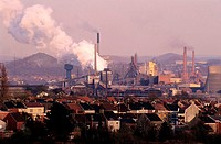 Belgium, Charleroi, residential area and factories with their slag heaps on the background