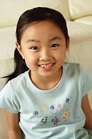 Young girl looking at camera