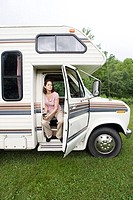 Mature woman sitting in a caravan