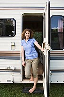 Woman standing in the doorway of a caravan