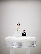 Bride and bridegroom figurines on a wedding cake