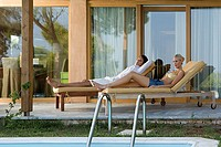 Couple on sunloungers