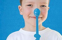 Boy with spoon on his nose