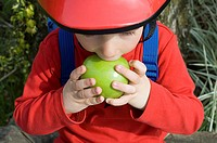 Boy eating an apple