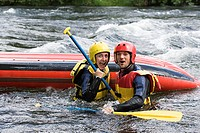 Two people white water rafting (thumbnail)