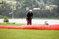 Male parachutist with red parachute