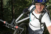Mountain biker carrying bike