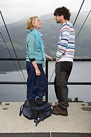 Young couple face to face on a bridge