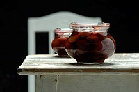 Stewed plum fruit in glass