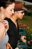 Man and Woman at Backyard Party