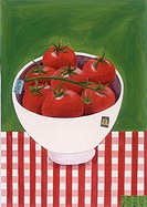 A bowl of tomatoes on the vine