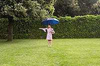 Girl with Umbrella in Garden