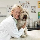 Veterinarian Embracing Terrier