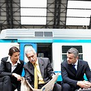 Businesspeople on Train Platform