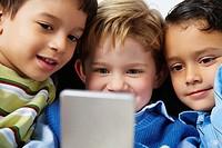 Boys Playing Handheld Video Game