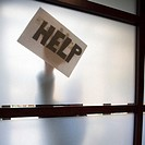 Help Sign Behind Window