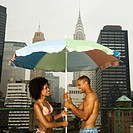 Couple with Sunshade on Rooftop