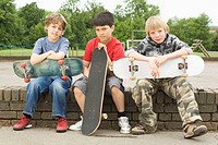 Boys Holding Skateboards