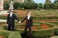 Businesswoman Leading Businessman Through Maze