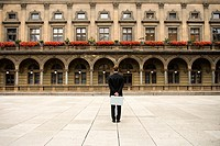 Businessman Standing in Square