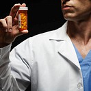 Doctor Holding Prescription Medication