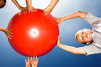 Boy Holding Exercise Ball with Friends