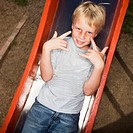Boy Lying Down on Slide (thumbnail)