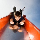 Boy Sliding Down Slide (thumbnail)