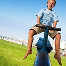 Boy Playing on Seesaw