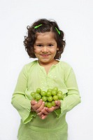 Girl Holding Green Grapes