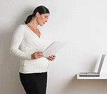 Pregnant Businesswoman Using Laptop