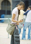 Teen girl looking at cell phone