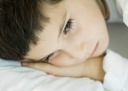 Child lying down, head on pillow, close-up