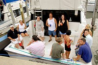 Crowds of people attend the festival celebration the Port Huron to Mackinaw Island Michigan sailboat race by celebrating at a large street party the n...