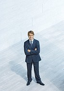 Businessman standing with arms folded, high angle view (thumbnail)