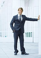 Businessman standing with hand in pocket, full length (thumbnail)