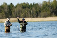 Two senior men fishing in the river