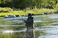 Side profile of a mature man fishing in the river