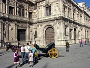 Tourists talking to carriage driver in front of Town Hall (Avenida de la Constitución / Plaza Nueva), Seville, Andalusia, Spain