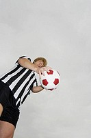 Low angle view of a soccer player holding a soccer ball (thumbnail)