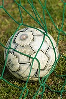 Close-up of a soccer ball in a net