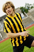 Close-up of a soccer player running in a soccer field