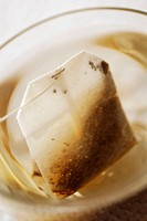 Close-up of a teabag in a saucer