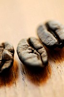 Close-up of three coffee beans