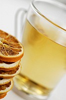 Close-up of lemon slices and a cup of herbal tea (thumbnail)