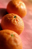 High angle view of three oranges