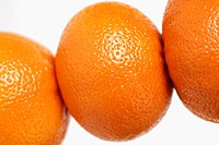 Close-up of three oranges