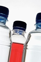 Close-up of three bottles full of liquid